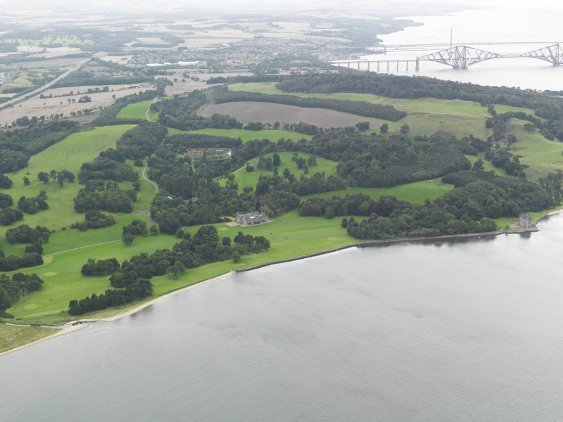 General oblique aerial view centred on the country house with Barnbougle Castle adjacent, taken from the E.