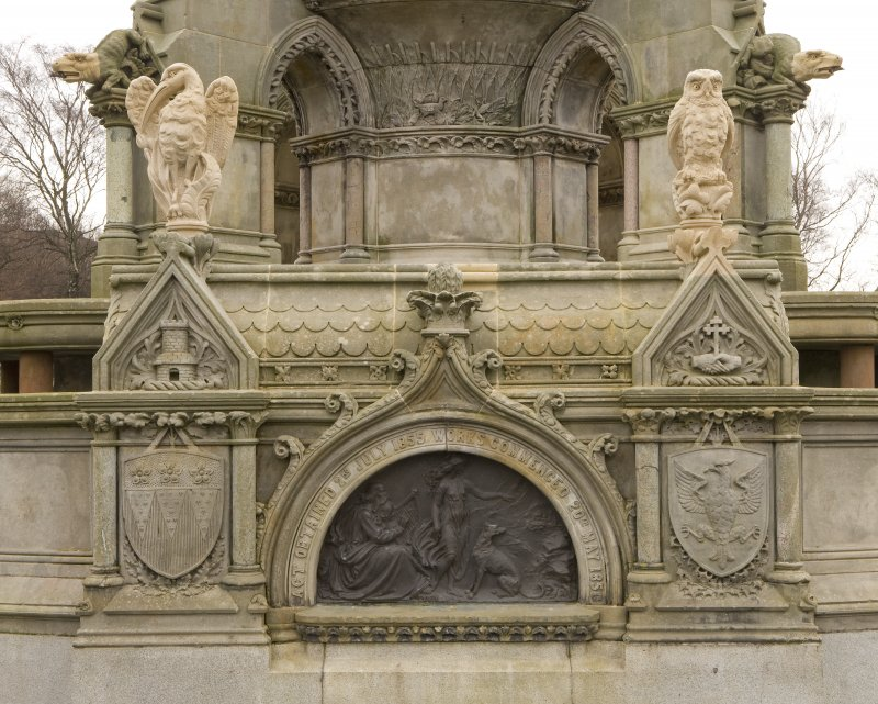 View of ogee-arched commemorative panel with flanking coats-of-arms and new avian sculpture. WNW face of the restored Stewart Memorial Fountain, Kelvingrove Park, Glasgow