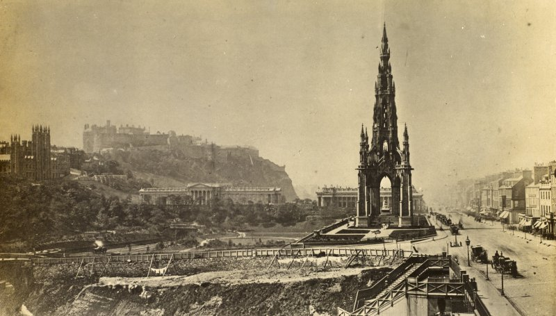 View of the Scott Monument, Edinburgh, from east and Princes Street with Edinburgh Castle and the Mound in the background.