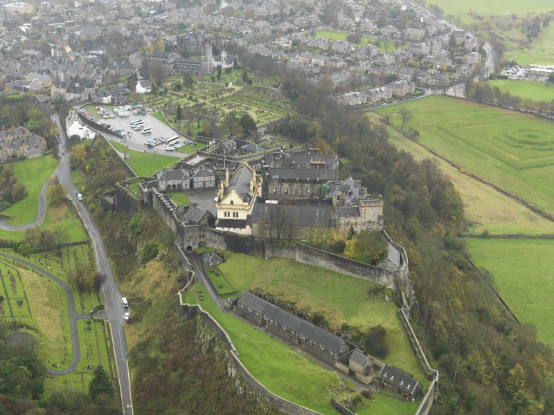Oblique aerial view centred on the castle, taken from the NW.