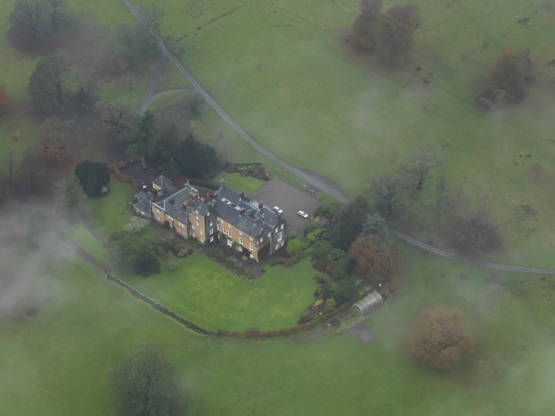 Oblique aerial view centred on the country house, taken from the SE.