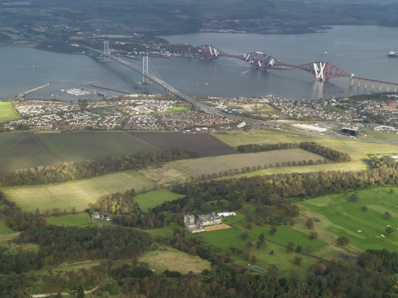 General oblique aerial view centred on the rail and road bridges, taken from the SW.