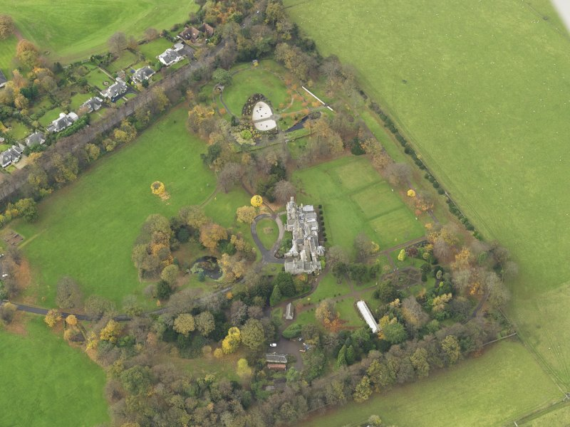 Oblique aerial view centred on castle with the policies adjacent, taken from the  ESE.