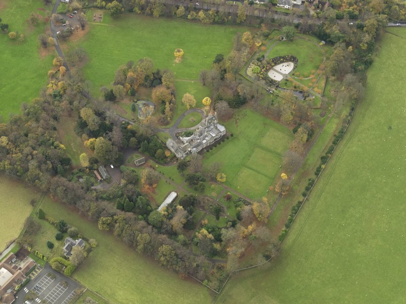 Oblique aerial view centred on castle with the policies adjacent, taken from the NE.