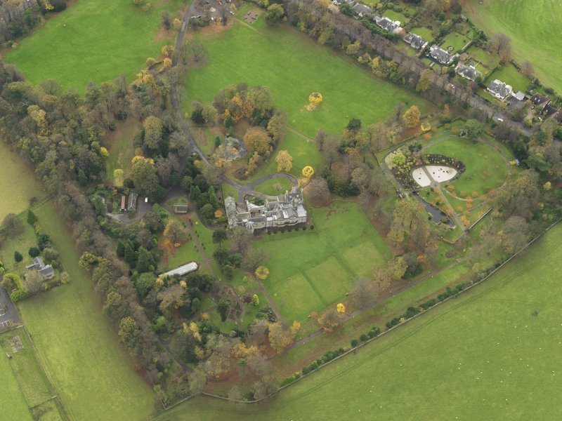 Oblique aerial view centred on castle with the policies adjacent, taken from the NNE.