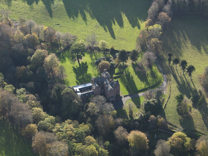 Oblique aerial view centred on the tower house/country house, taken from the NNE.