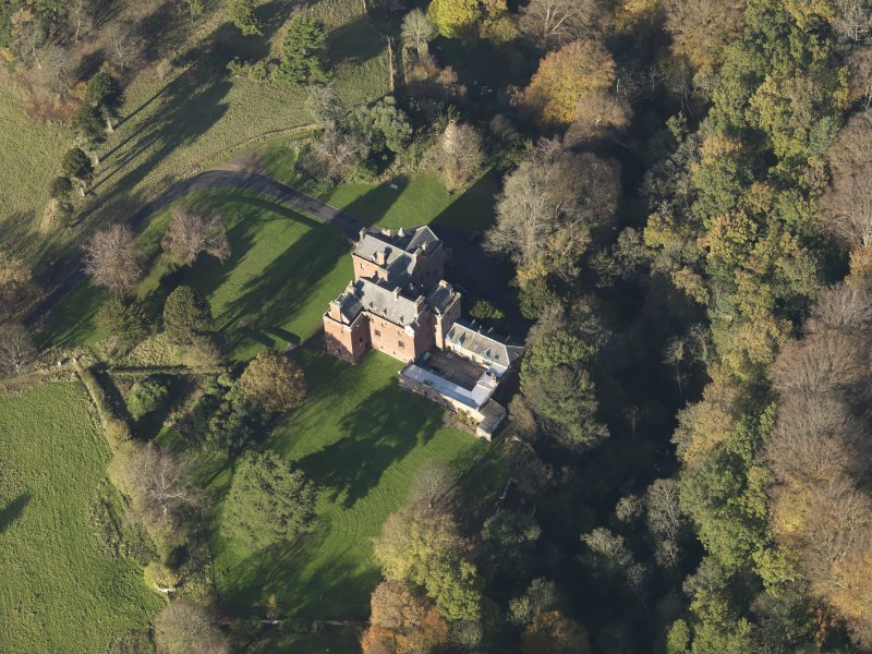 Oblique aerial view centred on the tower house/country house, taken from the SE.