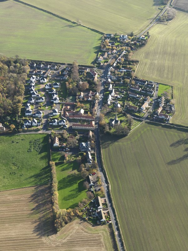 General oblique aerial view of the village, taken from the NW.