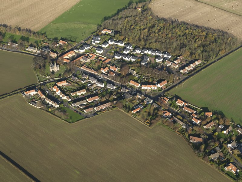 General oblique aerial view of the village, taken from the SW.