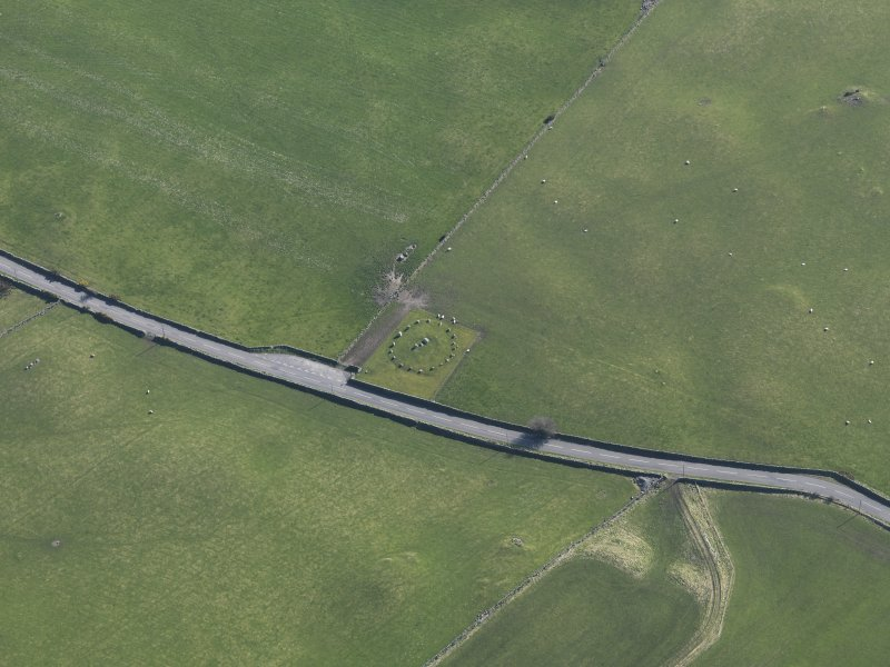 Oblique aerial view centred on Torhousekie stone circle, taken from the N.