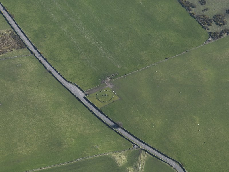 Oblique aerial view centred on Torhousekie stone circle, taken from the NNW.