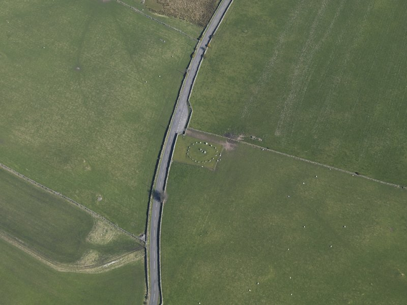 Oblique aerial view centred on Torhousekie stone circle, taken from the WNW.