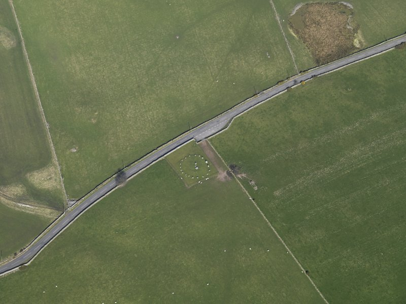 Oblique aerial view centred on Torhousekie stone circle, taken from the WSW.