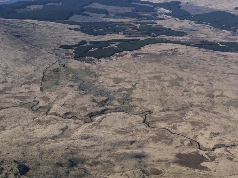 General oblique aerial view centred on the remains of the Woodhead lead mine, taken from the S.
