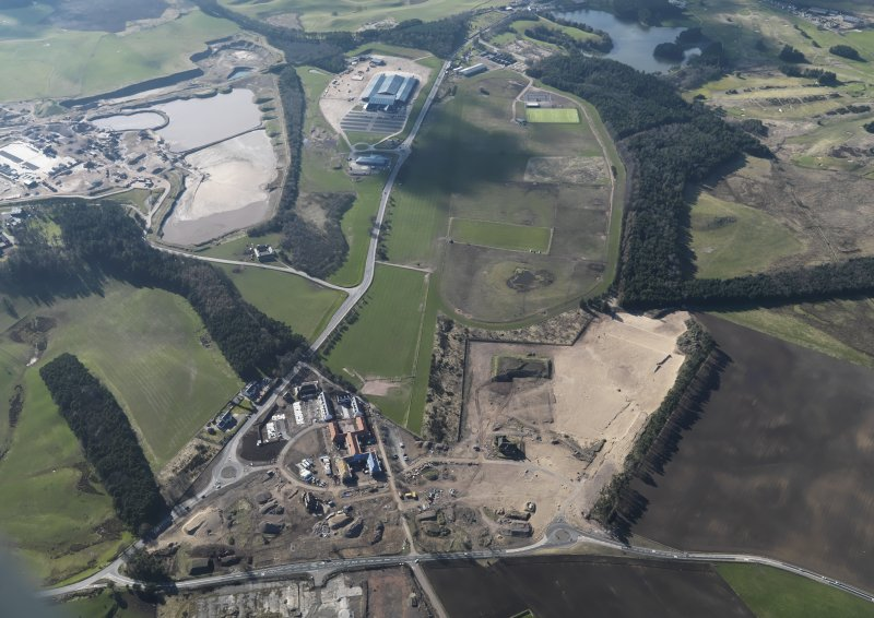 General oblique aerial view looking along Hyndford Road of the redevelopment of Winston Barracks with Lanark racecourse and the Hyndford sand and gravel workings beyond, taken from the ESE.