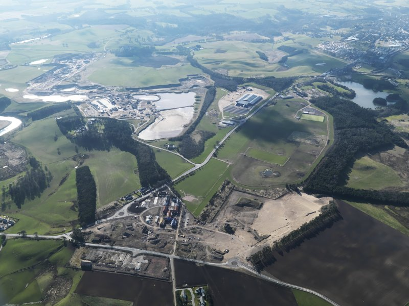 General oblique aerial view looking along Hyndford Road of the redevelopment of Winston Barracks with Lanark racecourse and the Hyndford sand and gravel workings beyond, taken from the E.