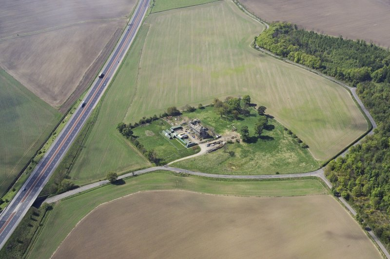 Oblique aerial view of Duntarvie Castle under restoration, taken from the SE.