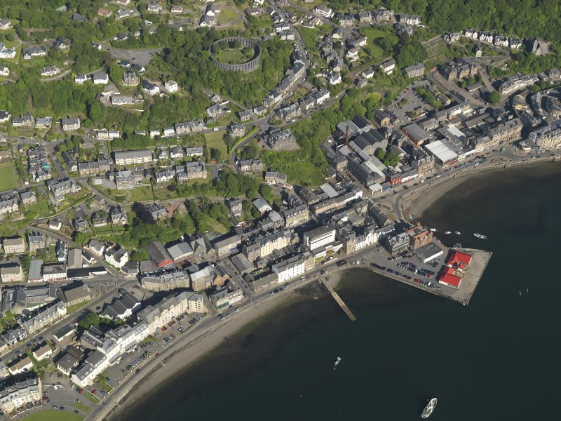 General oblique aerial view of Oban centred on the harbour, taken from the WNW.