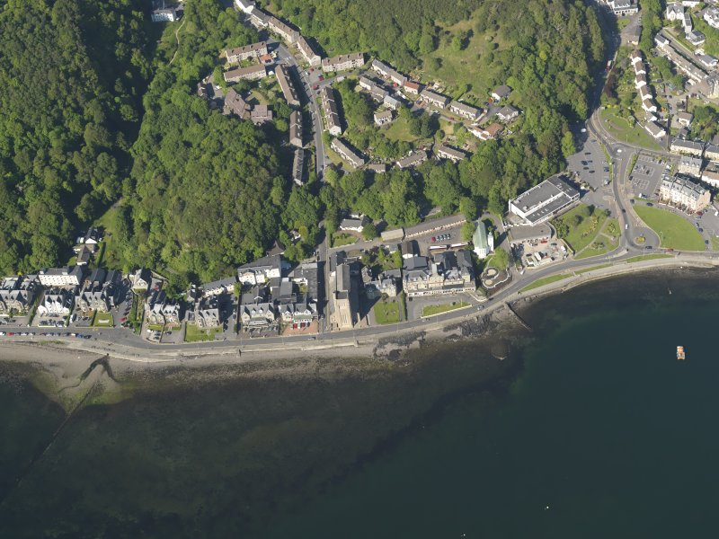 Oblique aerial view centred on St Columba's Roman Catholic cathedral, Oban, taken from the SW.