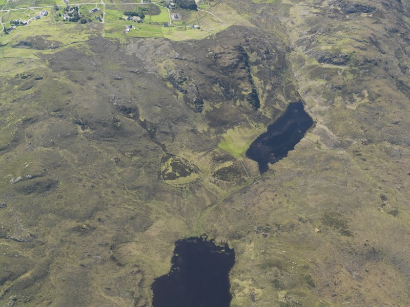 Oblique aerial view centred on the enclosures at Loch Coire an h-Airigh, taken from the E.