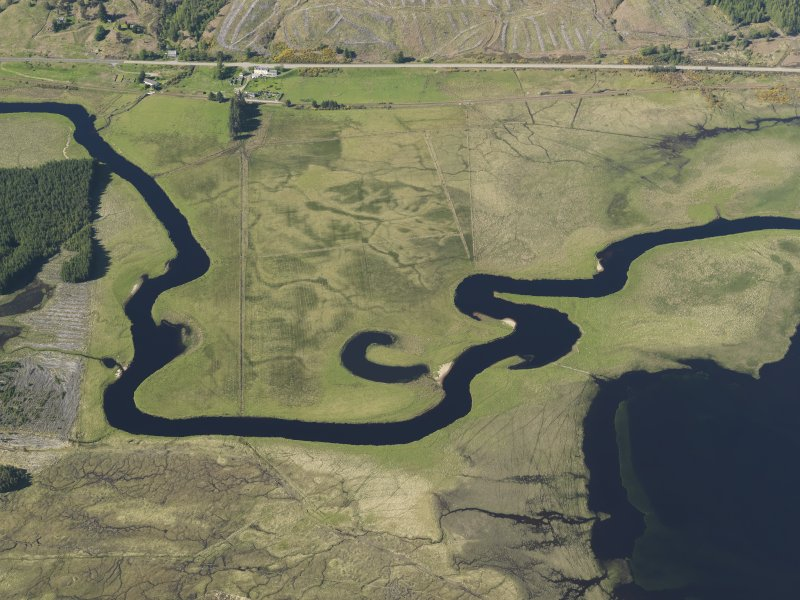 General oblique aerial view of Achanalt including the old river channels, taken from the S.