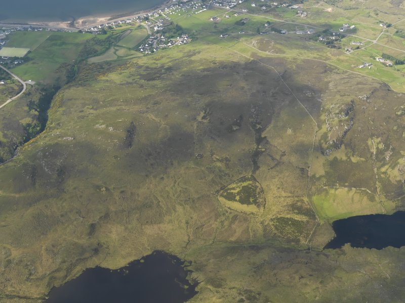 General oblique aerial view, taken from the NE.