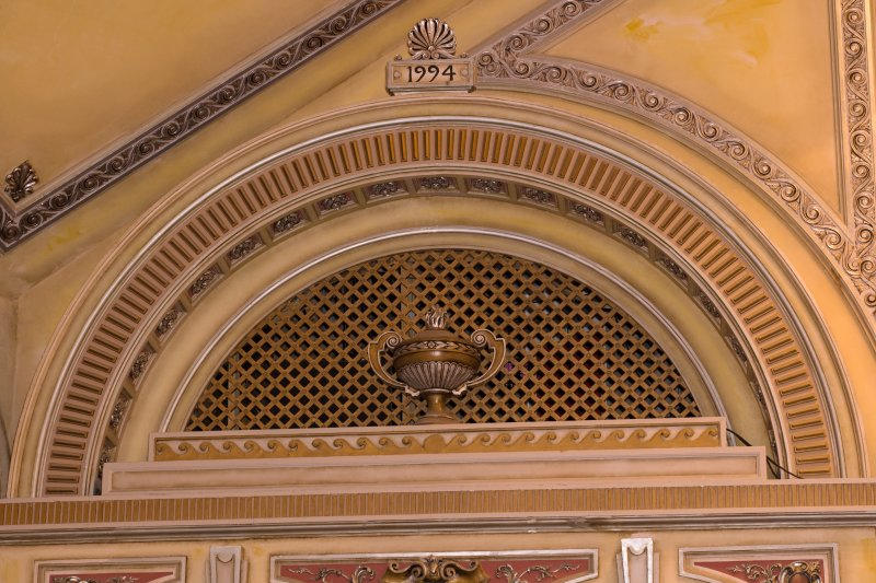 Interior. Auditorium, detail of pediment with urn above boxes to right of stage