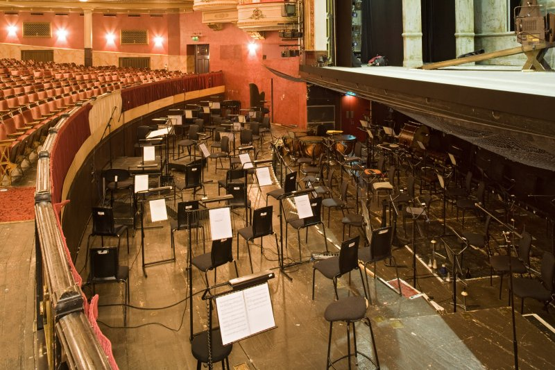 Interior. Auditorium, orchestra pit from N
