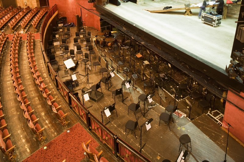 Interior. Auditorium, orchestra pit from balcony to N