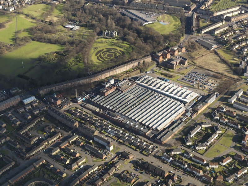 Oblique aerial view centred on the factory, taken from the W