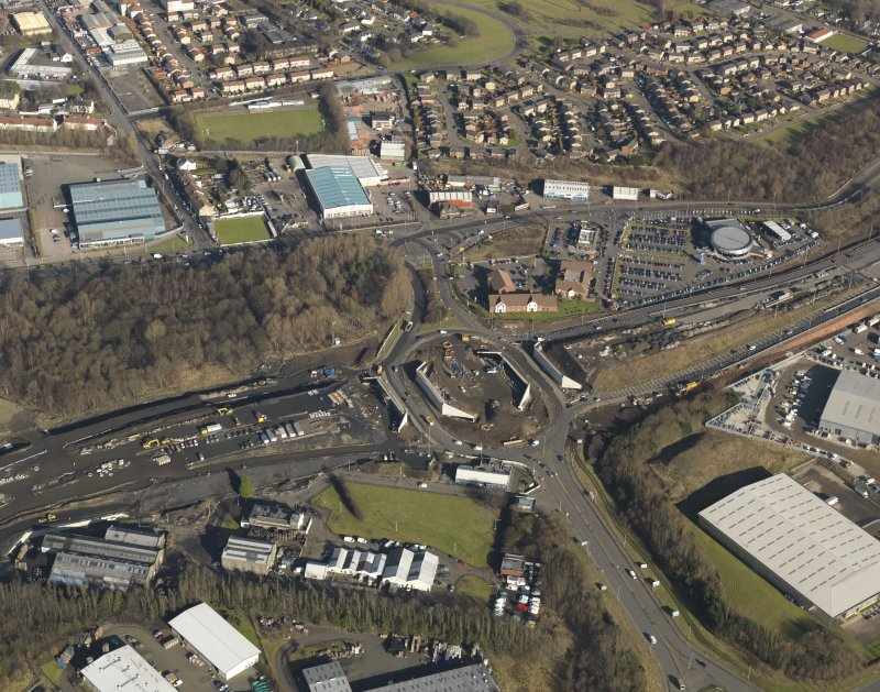 Oblique aerial view of M74 extension centred on the Fullerton Road junction (NS 6408 6239), taken from the SW.