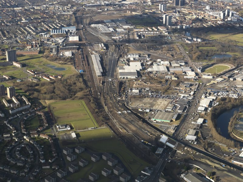 Oblique aerial view of the city showing the route of the M74 extension going through the Rutherglen to Polamadie area centred on Power Motive Works, taken from the ESE.