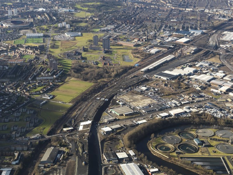 General oblique aerial view of Glasgow showing the route of the M74 extension going through the Rutherglen to Polamadie area centred on Power Motive Works, taken from the E.