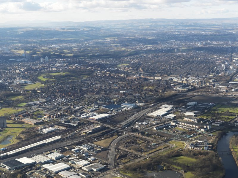 General oblique aerial view of Glasgow showing the route of the M74 extension going through the Polamadie area to the M74 centred on Pollockshields area looking SW, taken from the NE.