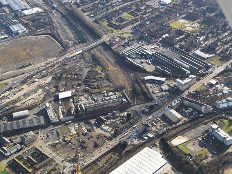 Oblique aerial view of the M74 extension going through the Port Eglinton area to the M74 centred on the grain and hay store, taken from the NW.