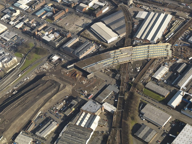 Oblique aerial view of the M74 extension going through the Port Eglinton area to the M74 centred on the Eglinton Street goods station, taken from the WSW.