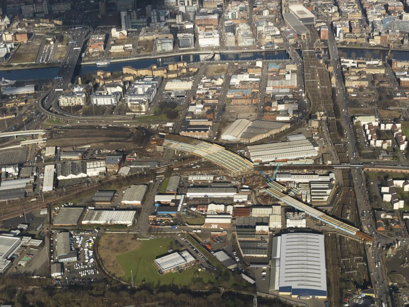 Oblique aerial view of the city centre showing M74 extension going through the Port Eglinton area to the M74 centred on the Eglinton Street goods station, taken from the S.
