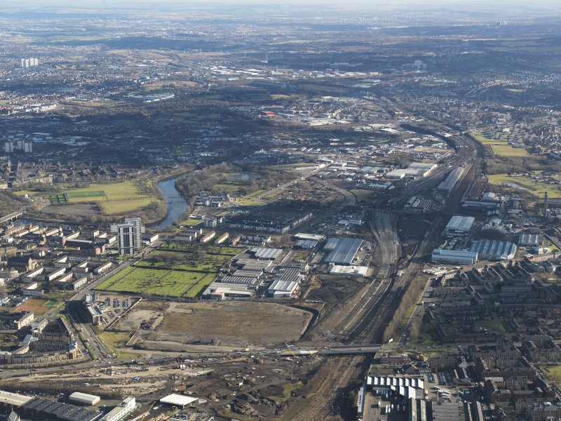 General oblique aerial view of Glasgow city centre showing M74 extension looking E, centred on the Polmadie area, taken from the W.