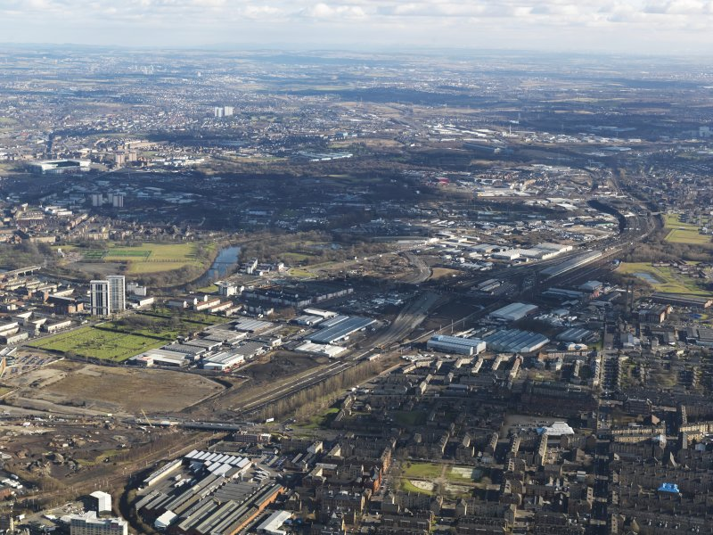 General oblique aerial view of Glasgow city centre showing M74 extension looking E, centred on the Polmadie area, taken from the WSW.