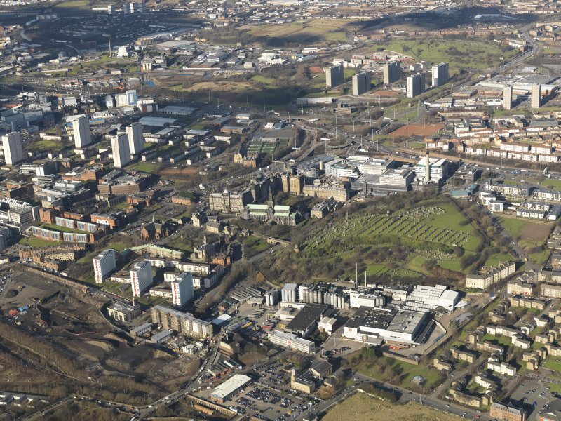 General oblique aerial view of Glasgow city centre, centred on the cathedral, taken from the SE.