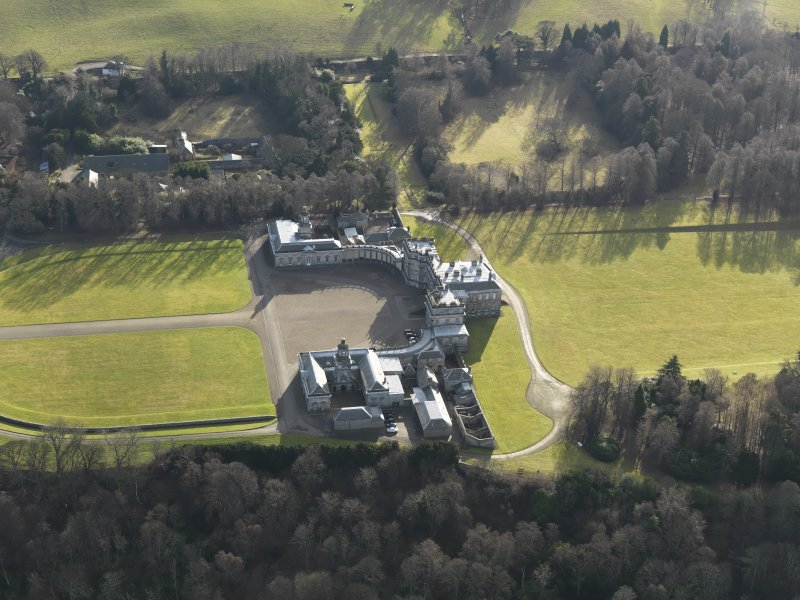 General oblique aerial view of the estate centred on Hopetoun House, taken from the NNE.