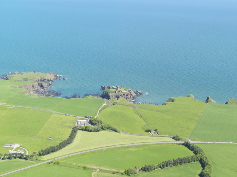 General oblique aerial view of the ruins of Dunnottar Castle, taken from the W.