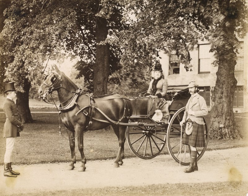 View of the Marquis and Marchioness of Huntly with horse and carriage at Aboyne Castle, 1878.