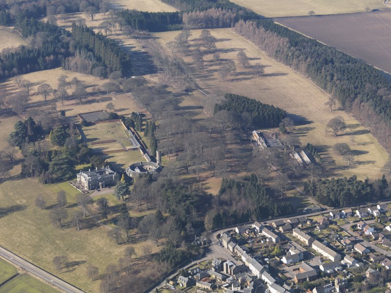 General oblique aerial view centred on the country house with the stable block adjacent, taken from the ESE.