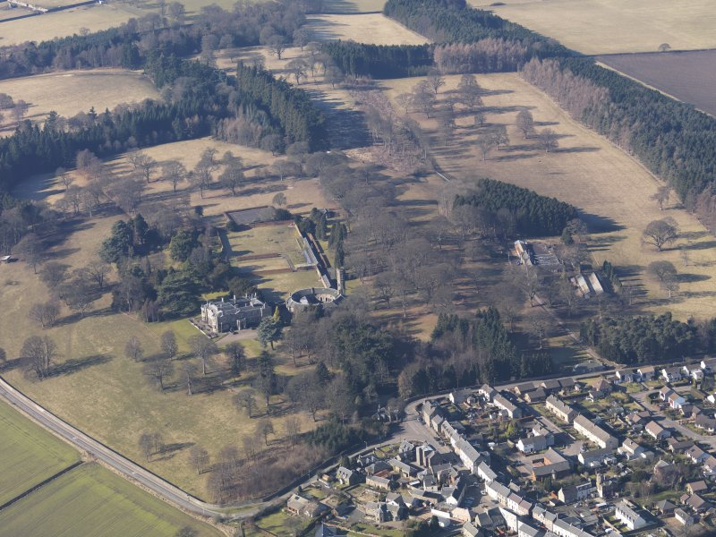 General oblique aerial view centred on the country house with the stable block adjacent, taken from the E.