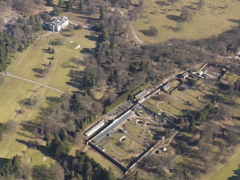 Oblique aerial view centred on the walled garden with the country house adjacent, taken from the SW.