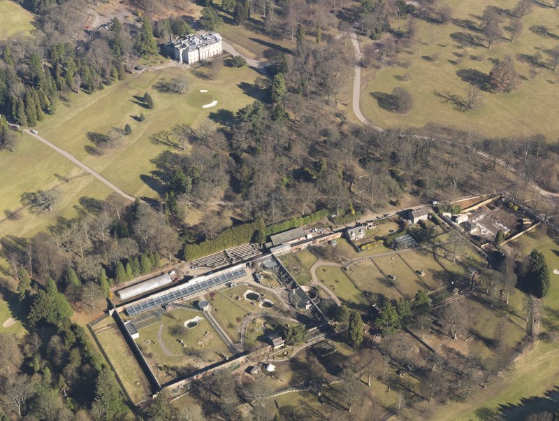 Oblique aerial view centred on the walled garden with the country house adjacent, taken from the  SSW.