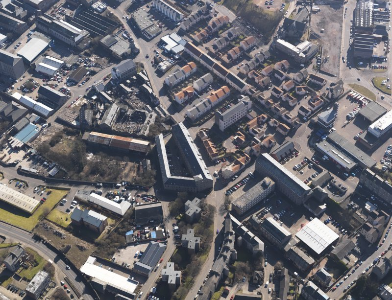 Oblique aerial view centred on the mills, taken from the NW.