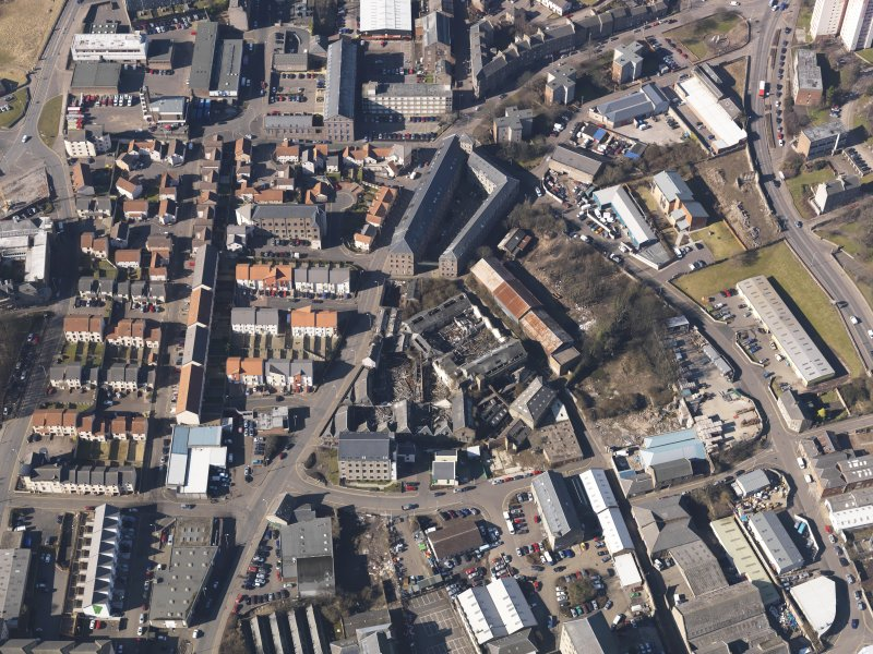 Oblique aerial view centred on the mills, taken from the E.