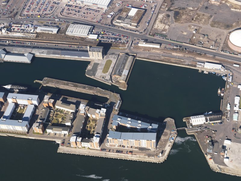 General oblique aerial view centred on the dock area, taken from the